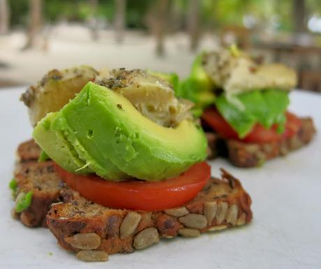avocado and tomato on freshly baked bread