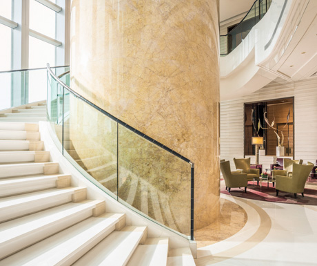 grand staircase in the lobby at Four Seasons Hong Kong