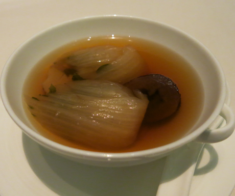 Double-boiled Matsutake mushroom soup with red date and vegetable.'