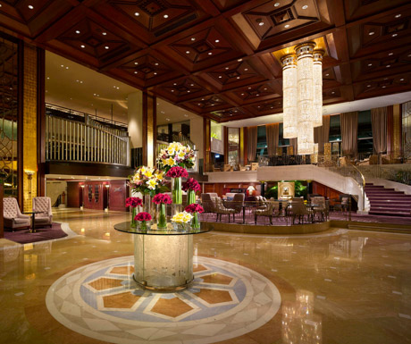 The grand lobby area with chandeliers and lavish flower displays.