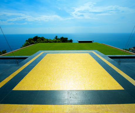 Paresa's gold tiled 'miracle lawn' stretches out to endless ocean views.