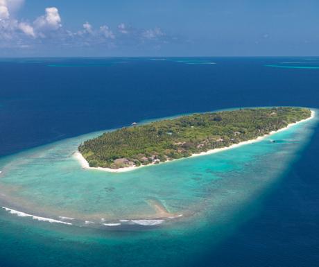 Aerial shot of the Soneva Fushi island in the Maldives