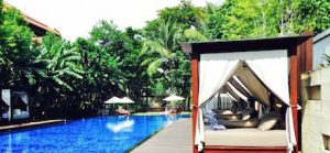 Day beds next to the pool at Conrad Bali Pool Suites