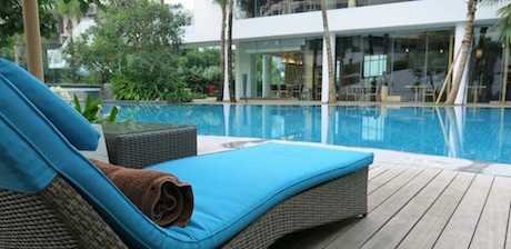 sunloungers next to swimming pool at swimming pool at DoubleTree Hilton Jakarta