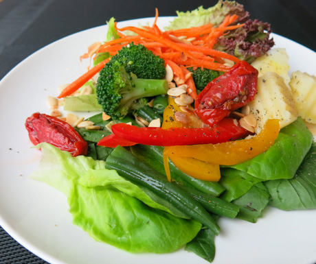 nutritious salad with nuts and sundried tomatoes