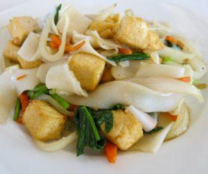 Flat noodles, vegetables and tofu at Navutu Dreams