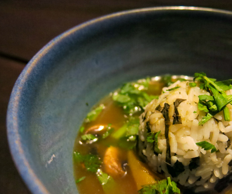 Soto sayur with spinach and rice ball