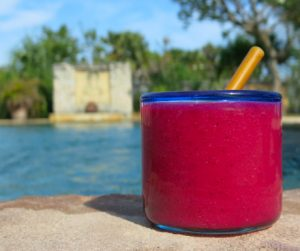 Vibrant and colourful dragon fruit juice next to the swimming pool