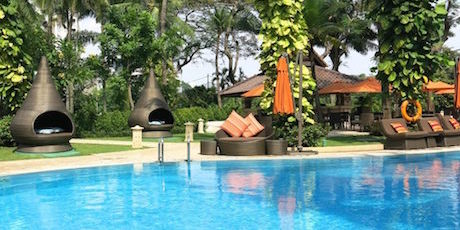 Tranquil and beautifully manicured gardens surrounding a huge pool at Shangri-La Jakarta