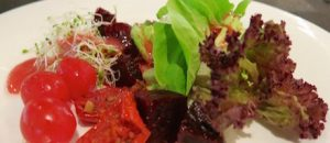Healthy plant based salad with raspberry dressing
