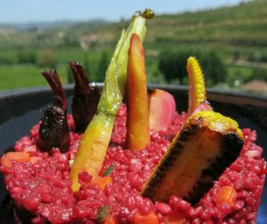 Bright, light, vibrant and beetroot couscous dish served with a remarkable view at Six Senses Douro Valley