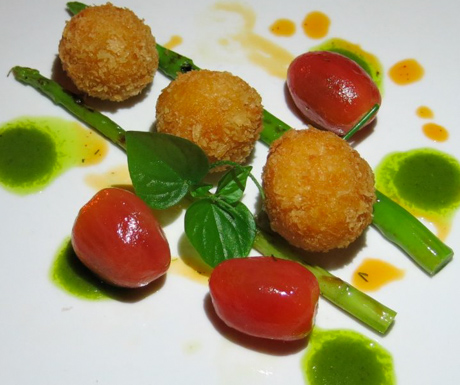 Spiced Saffron Arancini with Chargrilled Asparagus, Smoked Tomato and Rocket Oil