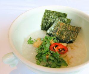 Plain rice congee topped with nori seaweed at Sofitel Legend Metropole Hanoi