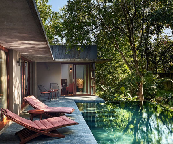 sunloungers next to the pool in a Private Pool Villa at Templation