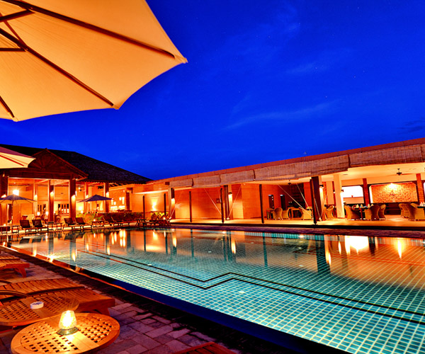 Swimming pool and restaurant at Bagan Lodge