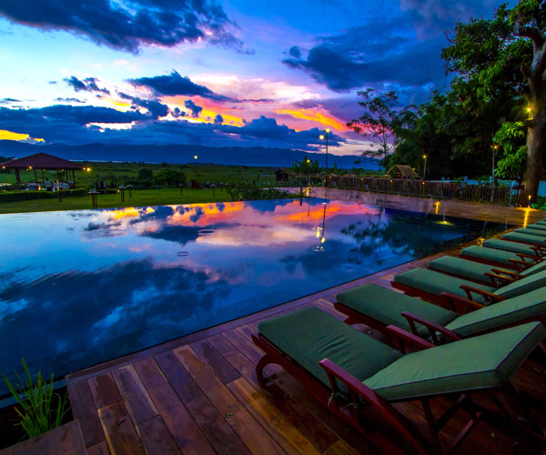 Amazing sunset views from the swimming pool at Sanctum Inle Resort
