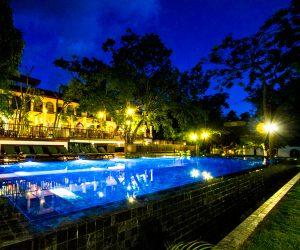 Swimming pool at night at Sanctum Inle Resort