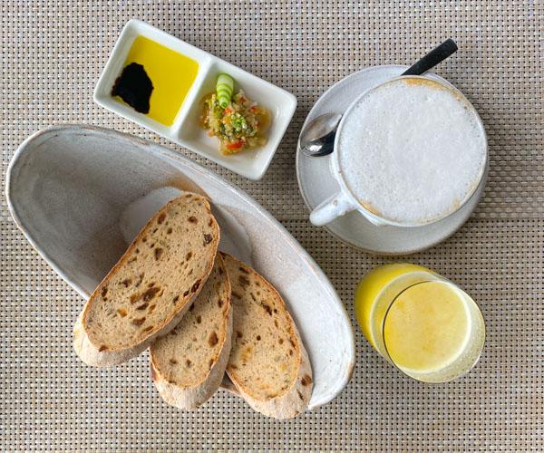Amber Kampot coffee, juice and fresh bread